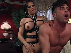 Lance bends over and takes a massive tranny cock deep in his ass. It hurts at first, but he works through the pain, because the way Foxxy's dick feels on his prostate is amazing. She pulls out and unloads her lady spunk all over her man.