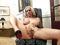 With giant melons and shaved beaver exposes her private parts