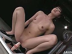 Japanese chick Kotomi Asakura got the mirror on the floor and set the sex toy 10-Pounder on it to engulf and fuck with it