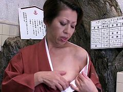 Japanese cougar is happy to play with her experienced pussy once again
