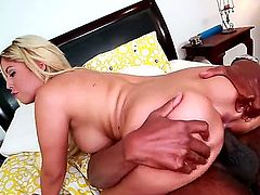 Bridgette B is a blonde with amazing curves. She is on top of a dude with a large black cock. He is sticking it inside her in this interracial video. She moans as he does it.