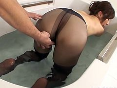 Reiko got in the tub and teased me with her luscious, long legs. They looked stunning while she was wearing her sheer black pantyhose. The naughty slut flashed her voluptuous ass and let me pleasure her twat with my tiny sex toy. She blew me, until I came.