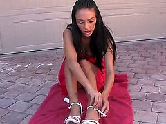 Stephanie Cane is naked on a towel. She is putting some lotion on her delicate skin. The solo girl pays special attention to her wet pussy and she fingers herself.