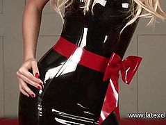 Sexy long legged blonde Alessandras latex fetish and bombshell beauty posing in her new shiny rubber outfit