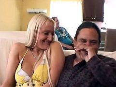 Big breasted blonde whore wants to ride on a Latino pecker. She sits in his lap, takes out her huge breasts and he started bathing in them.