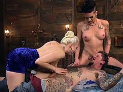 The hot blonde slut works on his cock, while shemale legend Morgan, shoves her cock in his mouth. He always wanted a threesome, but something this rough with a tranny is not what he had in mind. He is teased and humiliated beyond belief.