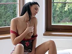 Beautiful black haired gal Shoves Her Whole Fist in Herself