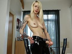 Latex pants are amazing on a dildo stroking British girl