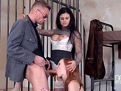 Threesome in a jail cell with two gorgeous sluts