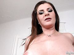 Brunette gal Kitty Jane finds herself horny enough and takes dildo in her pussy with desire