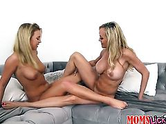 Blonde Cali Sparks with huge tits and smooth snatch spends her sexual energy with lesbian Brandi Love