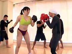Yes, you read it right. Lusty Japanese chick seduced her boxing coach, during the training session. She removed her shirt and showed him her big boobs. After that, she sucked their dicks and got brutally fucked by four cocks.