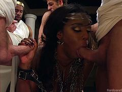 With her hands in chains, Lisa is persuaded to suck dicks and entertain her masters. These horny guys dressed as Roman emperors, can hardly wait to stuff their cocks down her throat and ass. Click to enjoy the inciting hardcore scenes!