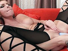 Sultry pornstar parts her legs to fuck herself with dildo