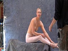 Nude blonde model and her photographer take pics