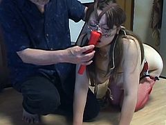 Voluptuous Japanese woman bound and naked aside from claret fishnet stockings is walked on a leash followed by having hot wax spattered all over her exposed big butt with English subtitles