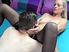 Luscious German mommy in black stockings gets fucked by a y
