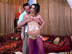 Fucking a hot and oily girl, was the dream of Erik. His dream was fulfilled by the lamp. He rubbed it and found a busty belly dancer standing in front of him. He couldn't control himself and started touching her boobs and pussy. The amazing girl made his night memorable.