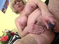 busty mature is pleasuring herself