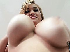 Sara Willis with massive tits and bald cunt goes solo for camera