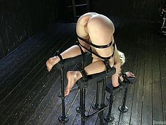 In this position, everybody can stick his dick in all of her holes. She is menacingly available and helpless. The severe executor irritates her bald pussy with electric vibrator, while groping her tits. Then in position head down, he sticks his gloved hands deep in her puffy cunt. It looks like he's going to...