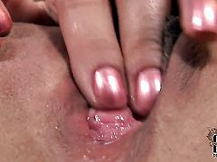 Completely cute kitty Eve Angel gives a closeup view of her love tunnel as she masturbates