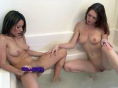 The bathtub is a great place for some super sexy lesbian sex with a couple of awesome tight ass brunettes. They eat pussy for a warm up and finish up the job with a big sex toy.