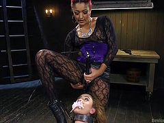 Roxanne's movements are restrained, as she's the prisoner of a merciless executor, who's attended by a sexy versed lady. While the man covers the naked bitch's mouth, to keep her silent, the naughty redhead uses a kinky vibrator to arouse her. Watch the inciting moments and enjoy!