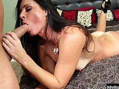 India Summer is a horny MILF with a fresh new tan. Shes extra horny today and keeps her black shoes on while getting fucked by this white dudes big hard dick. He also gets a black vibrator involved, and its enough to get her moaning before he busts his load all over her face.