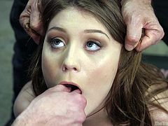 It was her first training day. They took brunette teen Jojo Kiss, into the basement, removed her clothes, tied her hands and small boobs with ropes. Masters pinched her ears and tongue. She tried to scream, but one of them inserted his dick in her mouth. She got on knees and he deepthroated her brutally