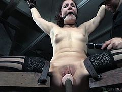 Kept under control in the basement by a meciless executor, this helpless lady is about to face a harsh treatment, involving steel restraints, humiliation and kinky sex toys. The guy stuffs a dildo in her peachy cunt, while she's continuously screaming and pain mixes with pleasure. Watch the inciting moments!