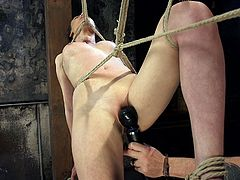 Looks like Casey is tangled in the ropes, but it's only illusion. The fact is, that she was carefully tied and suspended there by her severe master. He constantly stimulated her cunt with the help of vibrator and fingered her hole deeply. I should mention, that she enjoyed it a lot. Сunning rope bondage. Enjoy!