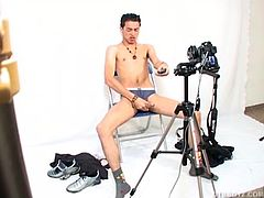 Latin twink William works as a photographer and decides to have some fun shooting himself jacking off in his studio. He sets his camera up and uses a remote to take photos of him stripping naked and stroking his big uncut cock up to rock hard. He gets some good closeup shots of his ass and then fingers his hole, before getting down to some determined stroking and a nice big load of cum all over his belly and chest.