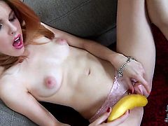 Amarna Miller with small tits and smooth twat playing with herself on camera