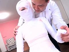 Highly bizarre Japanese medical fetish fantasy featuring a woman wrapped head to toe in bandages being indecently cared for by a supposed doctor with English subtitles