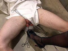 The cure for his insanity just might be this sexy shemale's huge cock. He is locked in the padded room, wearing a straight jacket, when the tranny nurse tortures his scrotum. He has to take her massive cock down his throat.