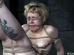 Slutty Elizabeth is about to experience hard bonding, while kept under control by a merciless ebony executor. The man gagged the tattooed blonde bitch and slapped her ass with a stick. Tits torture is part of the game, so don't miss the kinky bdsm scenes!