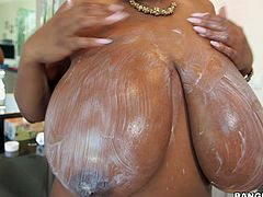 Watch the eye-catching big black boobs in action. Her dress can't hide those huge natural titties and her husband, can't wait after seeing them. His big black cock became erect, as she welcomed him in tight dress and he started screwing her within seconds.