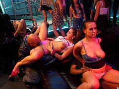 Gorgeous ladies doing some sloppy sucking in the kinkiest nightclub