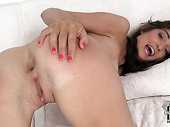 Charlotta with bald snatch gives a closeup view of her wet spot while masturbating with sex toy