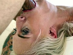 cute blonde gets her throat fucked hard