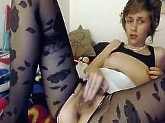 Horny girl in ripped pantyhose  masterbates