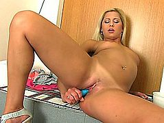 Enjoyable golden-haired Candy Love and her cute blue sex tool