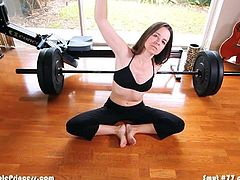 Yoga woman takes cum loads while fully dressed from two men