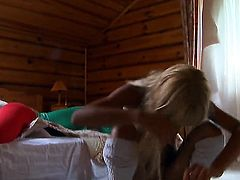 Blonde strips naked and plays with her hole