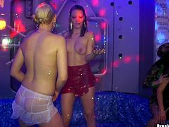 Impressively sexy bombshells present an incredibly hot shower orgy in the club