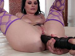 Veruca doesn't hide the fact she likes big cocks in her mouth, pussy and even her ass. Owen helps her out with a huge black dildo, to get her booty warmed up for his cock, to go sliding right in it. Wow!