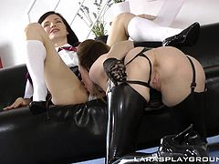 Lara knows how to heat the situation up and her latex stockings proves this. She starts with Lina's lace panties, licking them slowly. It's crazily excites and her pussy juice starts dripping. Then it's time for her wet pink hole and Lara slides her tongue inside... Lina moans from pleasure. Hot!