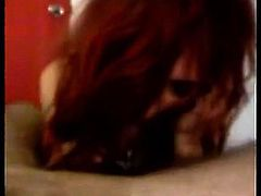 Redhead girl gives blowjob that is enthusiastic to her man