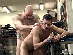 In the work shop, muscular and inked Roberto Cruiz lets Jack Bloom suck his dick, something the boy has been wanting to do for a long time. The young man goes to town on that big uncut cock and doesnt stop until he is showered in warm cum. We leave him with cum dripping off his chin, chest and leg.